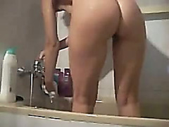 hot cutie takes shower and shows moist booty
