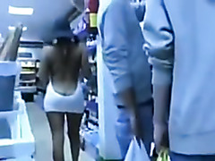 Lady flashing her sexy body in store