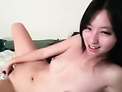 Tinkerbell using a dildo in her vagina and rubbing her clitoris.