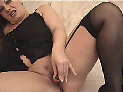 Older big beautiful woman stuffing her twat