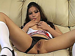 Lustful Latin Honey in a schoolgirl uniform plays with herself