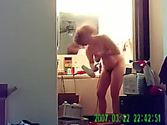 Obese busty girlfriend drying her hair after shower